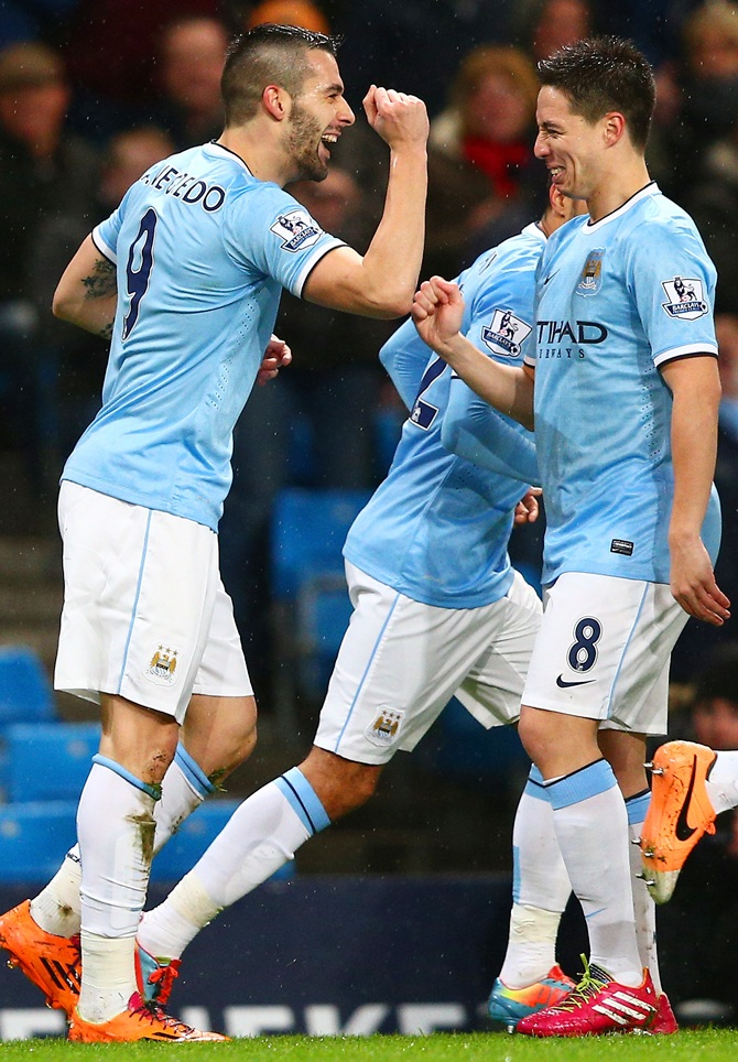 Alvaro Negredo of Manchester City celebrates scoring the opening goal with Samir Nasri