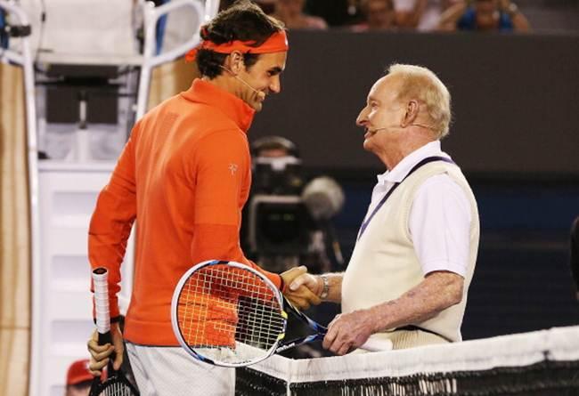 Roger Federer and Australian tennis legend Rod Laver shake hands after a hit during the Roger Federer charity match at Melbourne Park