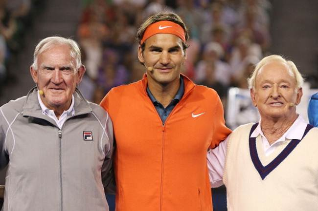 Australian tennis legends Tony Roche (left) and Rod Laver pose with Roger Federer