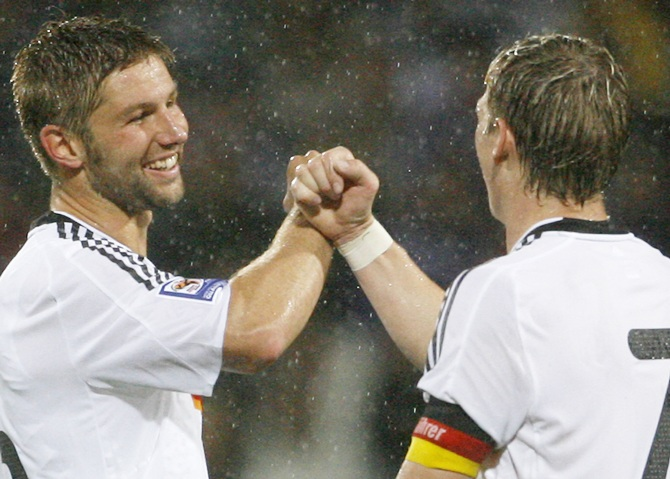 Germany's Thomas Hitzlsperger (left) and teammate Bastian Schweinsteiger