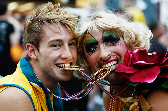 Australian Olympic gold medal winning diver Matthew Mitcham poses with Joyce Maynge