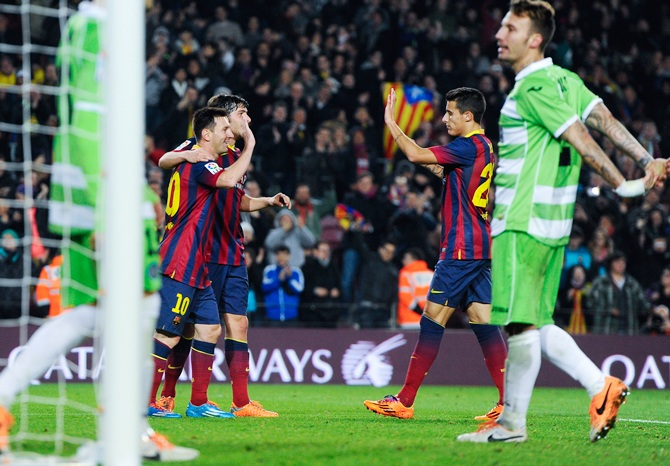 Lionel Messi of FC Barcelona celebrates with his teammates