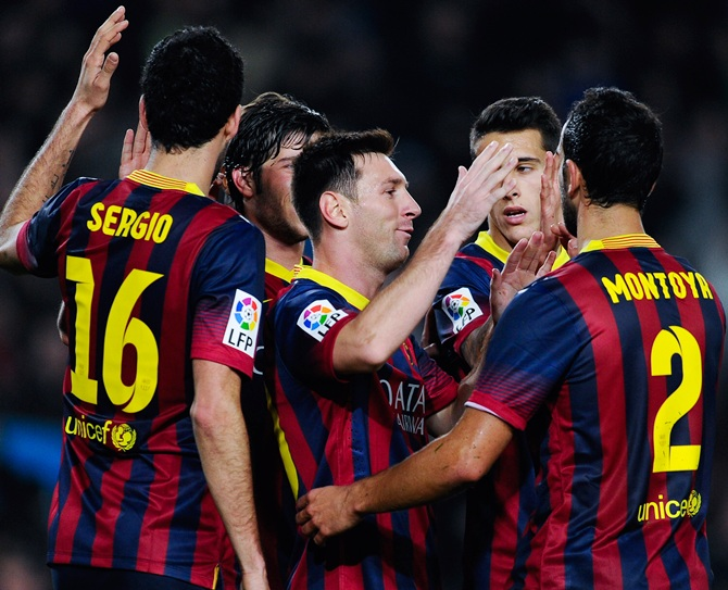 Lionel Messi of FC Barcelona celebrates with his teammates after scoring his team's third goal