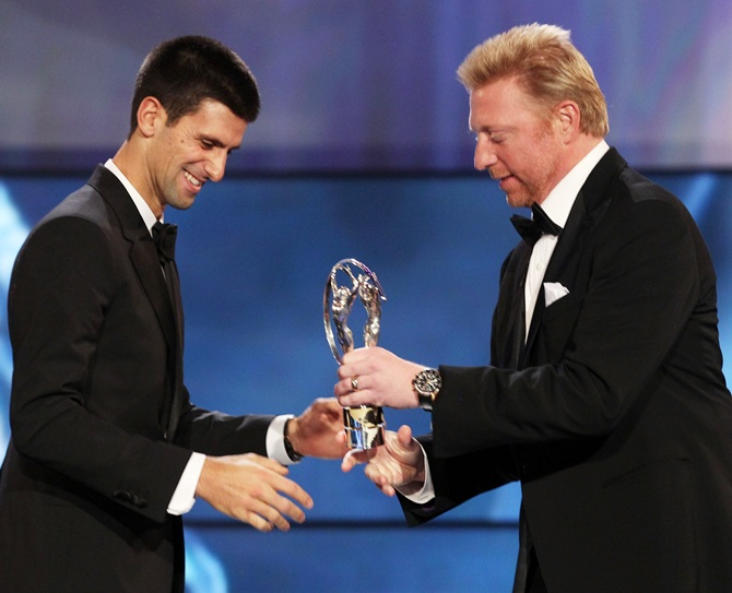 Boris Becker hand over the trophy to Novak Djokovic winner of the Laureus World Sportsman of the Year 2012