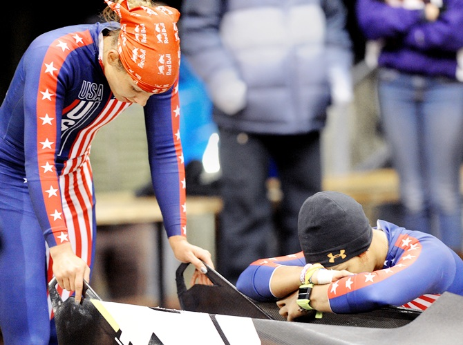 Brakewoman Lolo Jones and her bobsled pilot Jazmine Fenlator react to their third place finish during the bobsled selection runs