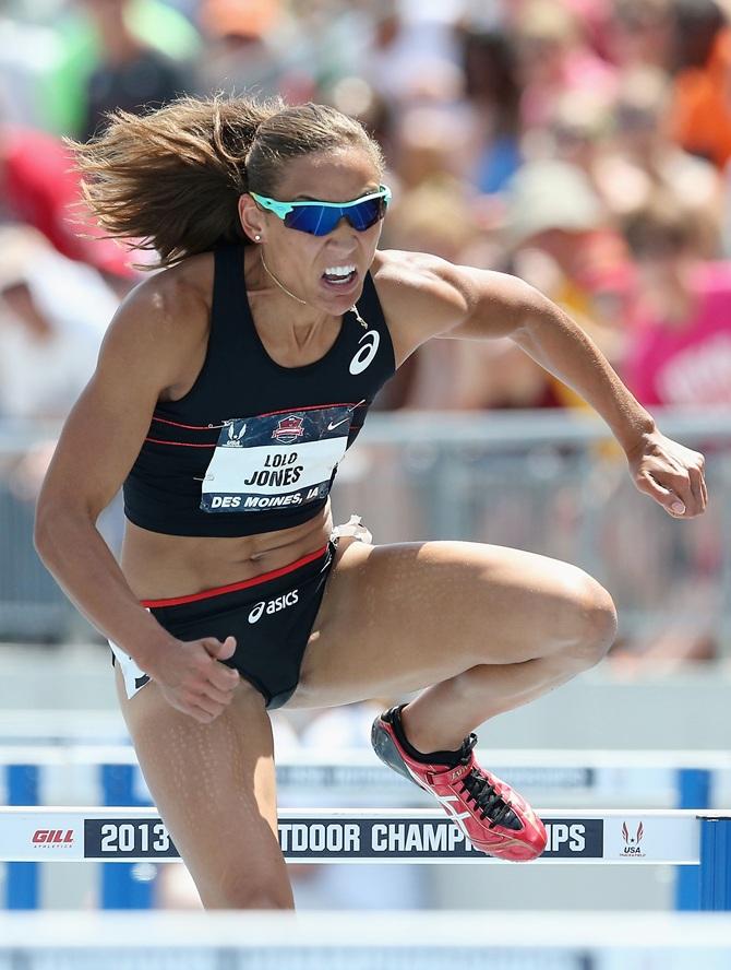 Lolo Jones competes in the semi final Women's 100 Meter Hurdles