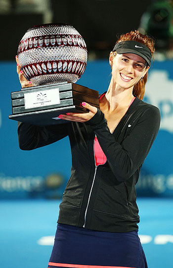 Tsvetana Pironkova of Bulgaria poses with the trophy after winning the Womens Singles Final match against Angelique Kerber of Germany at the Sydney International at Sydney Olympic Park Tennis Centre on Friday