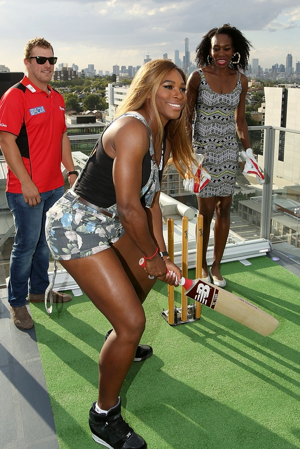 Serena Williams of the USA is coached in cricket batting by Aaron Finch of the Melbourne Renegades