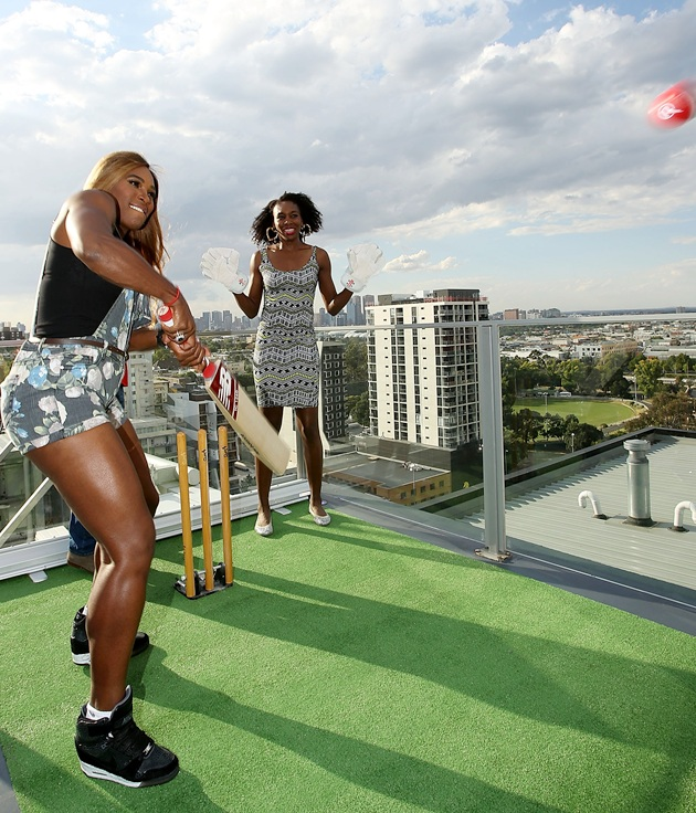 Venus Williams (right) and sister Serena Williams of the USA try batting