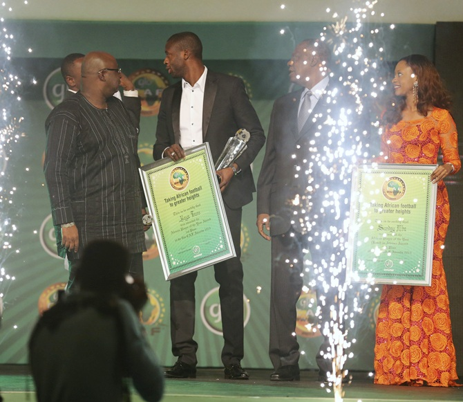 Manchester City and Ivory Coast midfielder Yaya Toure (centre) holds his   plaque after winning the African Footballer of the Year at the 2013 Confederation of African Football (CAF) Awards ceremony in Lagos