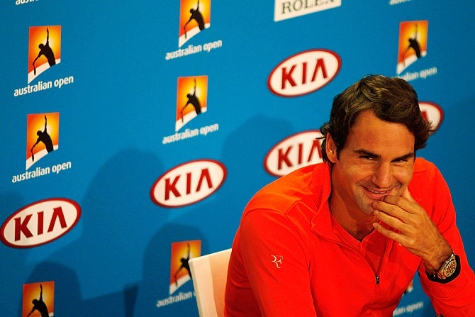 Roger Federer of Switzerland speaks at a press conference on Saturday