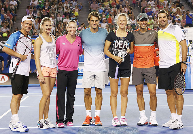 Lleyton Hewitt, Eugenie Bouchard, Samantha Stosur, Roger Federer, Victoria Azarenka, Rafael Nadal and Pat Rafter pose following the Rod Laver Arena Spectacular as part of Kids Tennis Day ahead of the 2014 Australian Open at Melbourne Park in Melbourne on Saturday