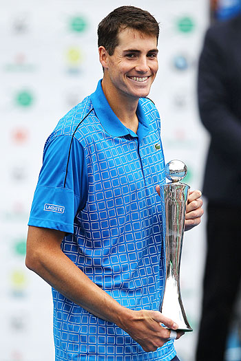 John Isner of United States poses with the trophy after winning the singles final against Yen- Hsun Lu of Taiwan in Auckland on Saturday