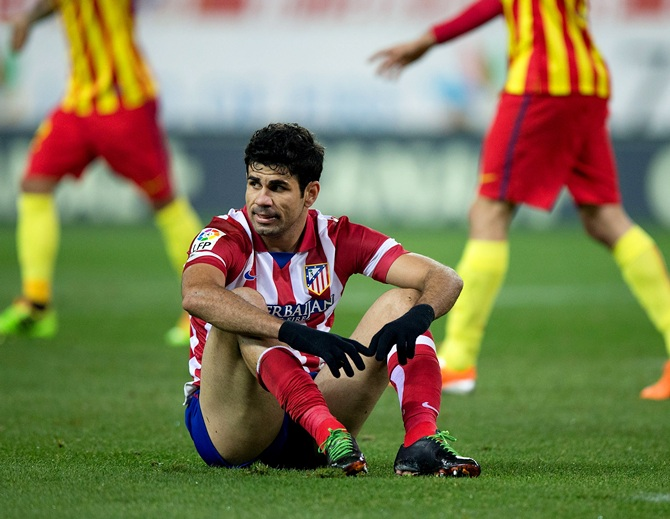Diego Costa of Atletico de Madrid sits on the ground after failing to score