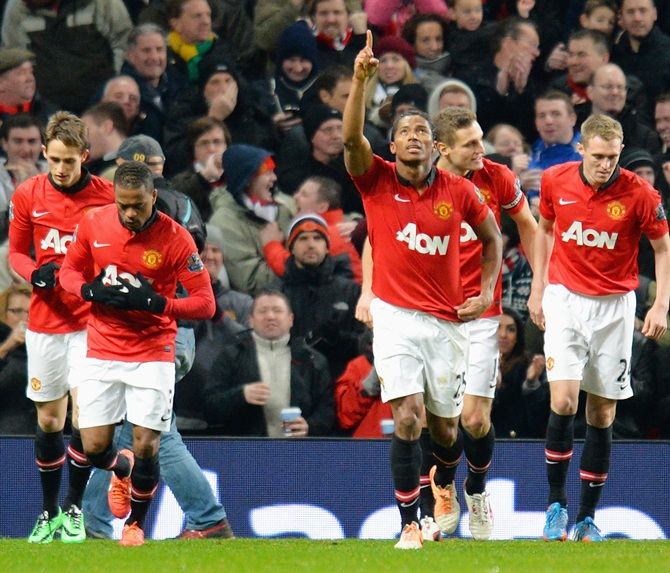 Luis Antonio Valencia of Manchester United celebrates scoring the opening goal