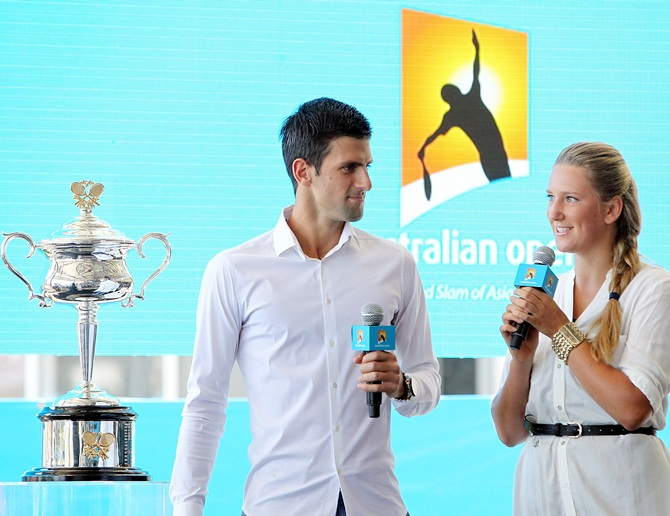 Novak Djokovic of Serbia (left) and Victoria Azaren