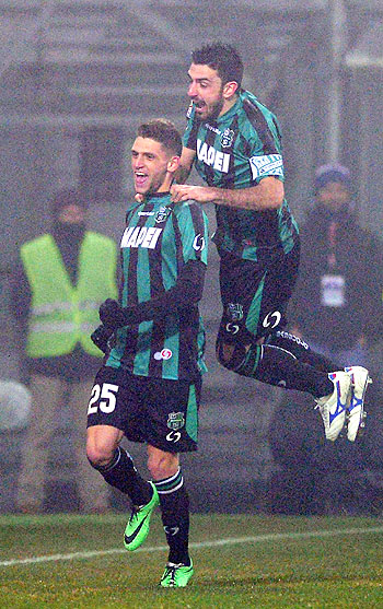 Domenico Berardi of US Sassuolo Calcio (left) celebrates scoring his fourth goal during their Serie A match against AC Milan in Sassuolo, on Sunday