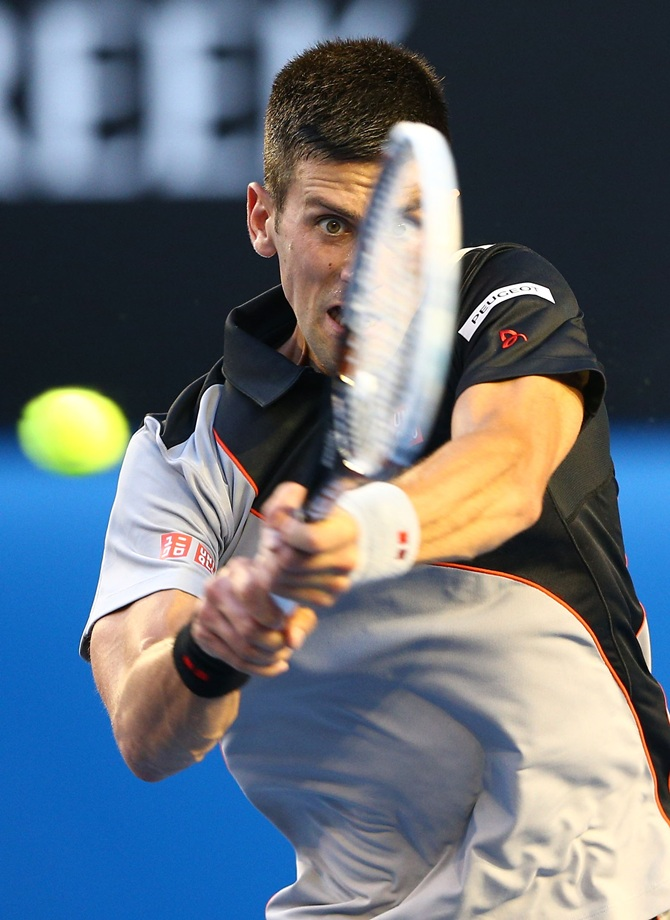 Novak Djokovic of Serbia plays a backhand in his first round match against Lukas Lacko of Slovakia at the Australian Open