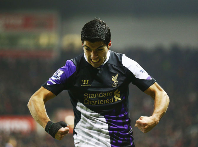 Luis Suarez of Liverpool celebrates after scoring against Stoke City at Britannia Stadium in Stoke on Trent, on Sunday