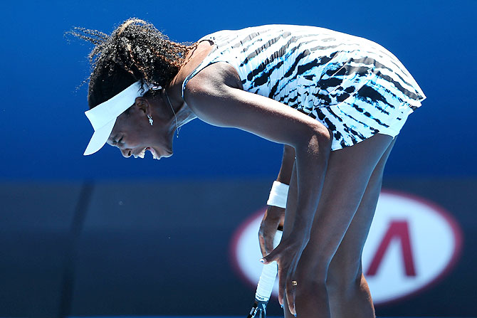 Venus Williams of the United States reacts during her first round match against Ekaterina Makarova of Russia at the Australian Open at Melbourne Park on Monday