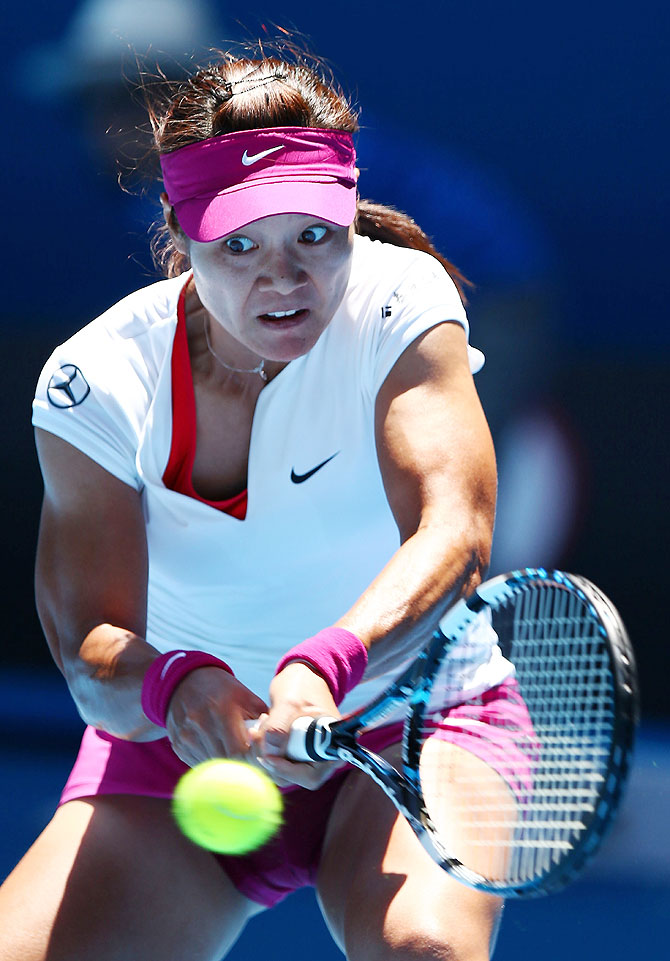 Li Na of China plays a backhand in her first round match against Ana Konjuh of Croatia at the Australian Open at Melbourne Park on Monday