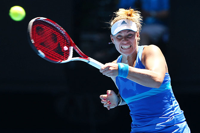 Angelique Kerber of Germany plays a forehand against Jarmila Gajdosova of Australia in their first round match of the Australian Open at Melbourne Park on Monday