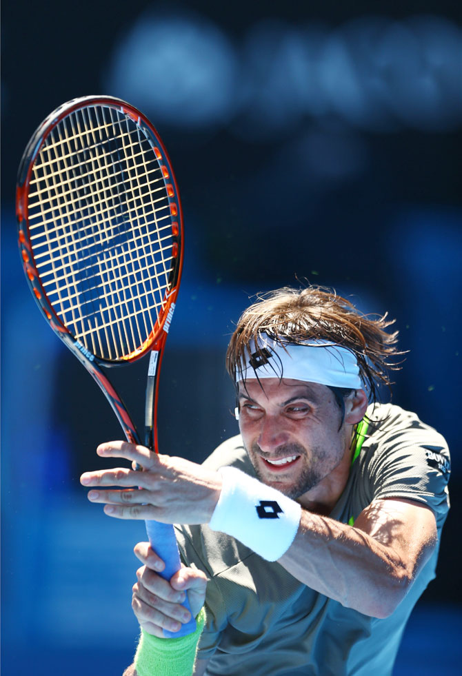 David Ferrer of Spain plays a backhand in his first round match against Alejandro Gonzalez of Colombia on Monday