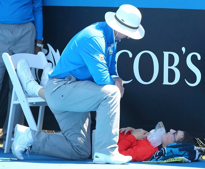 A ballboy faints in the heat, as Melbourne heads towards 43 degrees celsius