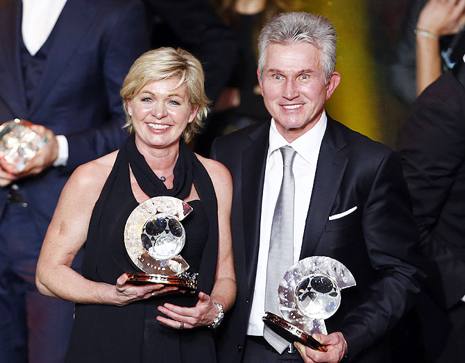 FIFA Coach of the Year Jupp Heynckes (right) poses with Women's world coach of the year Silvia Neid of the German women's national team