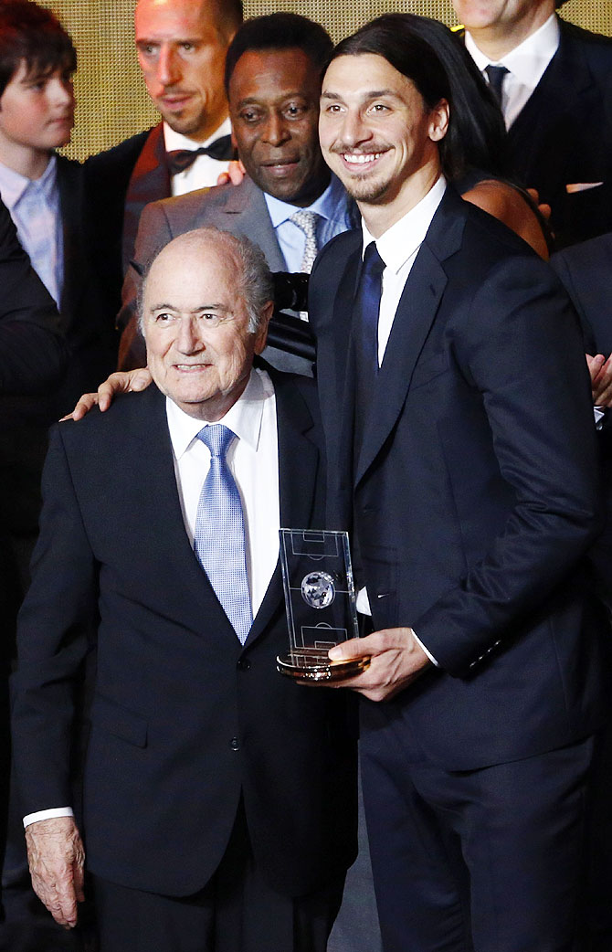 Sweden's Zlatan Ibrahimovic (right), winner of the FIFA Puskas Award for Goal of the Year, poses with FIFA President Sepp Blatter on Monday