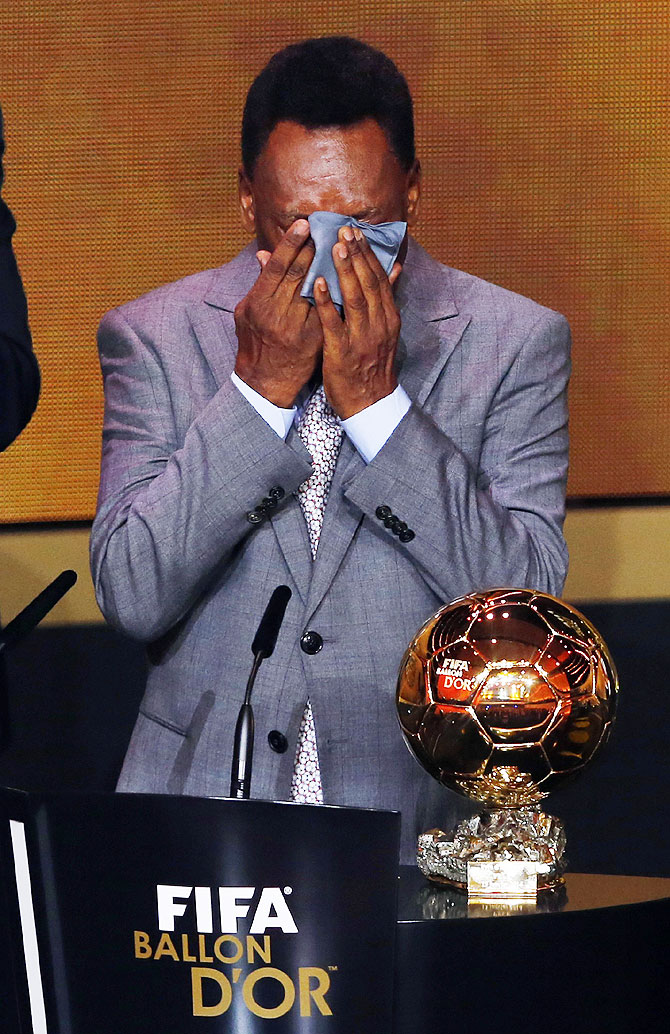 Pele reacts after receiving the FIFA honorary award or the Prix d'Honneur during the FIFA Ballon d'Or 2013 soccer awards ceremony on Monday