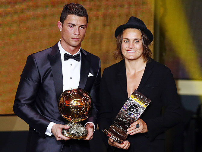 FIFA Ballon d'Or 2013 winner Cristiano Ronaldo (left) of Portugal poses with Women's World Player of the Year winner Nadine Angerer of Germany during the FIFA Ballon d'Or 2013 soccer awards ceremony in Zurich on Monday
