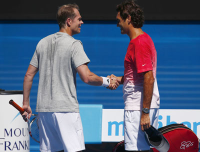 Roger Federer of Switzerland and coach Stefan Edberg of Sweden at a practice session at the Australian Open in Melbourne on Tuesday