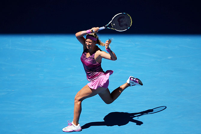 Victoria Azarenka of Belarus plays a forehand in her first round match against Johanna Larsson of Sweden at the Australian Open at Melbourne Park on Tuesday