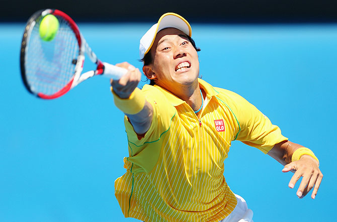 Kei Nishikori of Japan plays a forehand in his first round match against Marinko Matosevic of Australia at the Australian Open at Melbourne Park on Tuesday