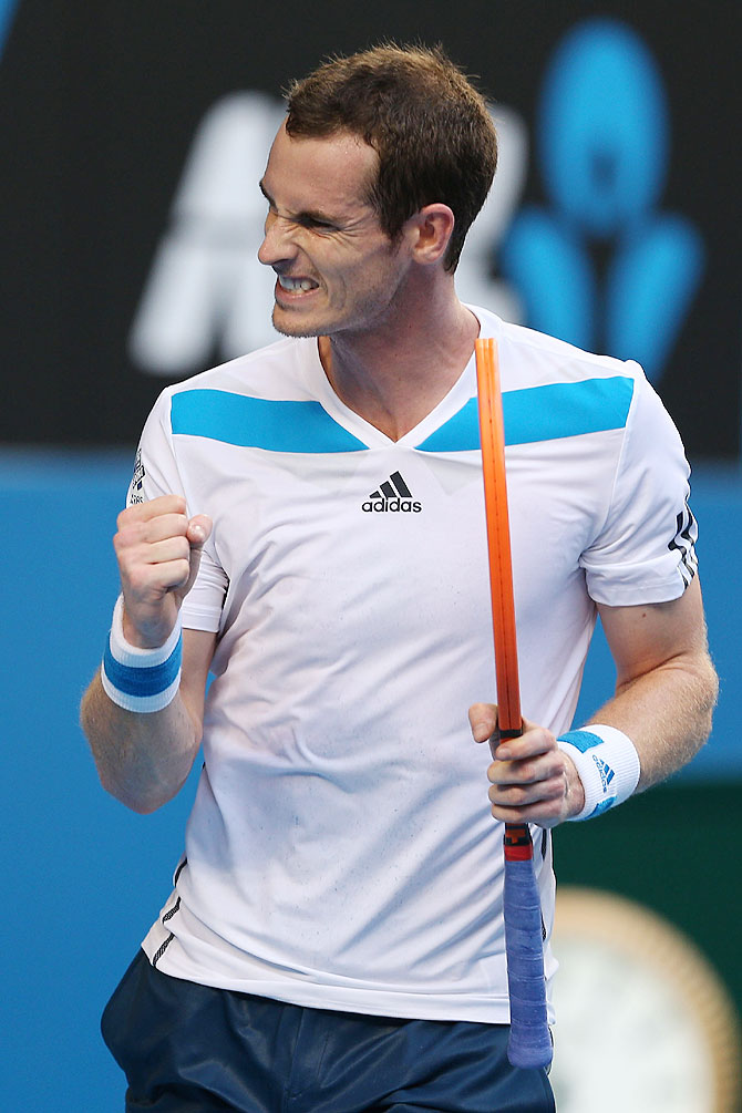 Andy Murray of Great Britain celebrates winning a point in his first round match against Go Soeda of Japan on Tuesday