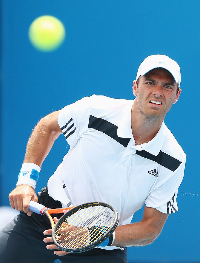 Ross Hutchins of Great Britain serves in his first round doubles match with Colin Fleming of Great Britain against Marinko Matosevic of Australia and Michal Przysiezny of Poland at the Australian Open on Wednesday