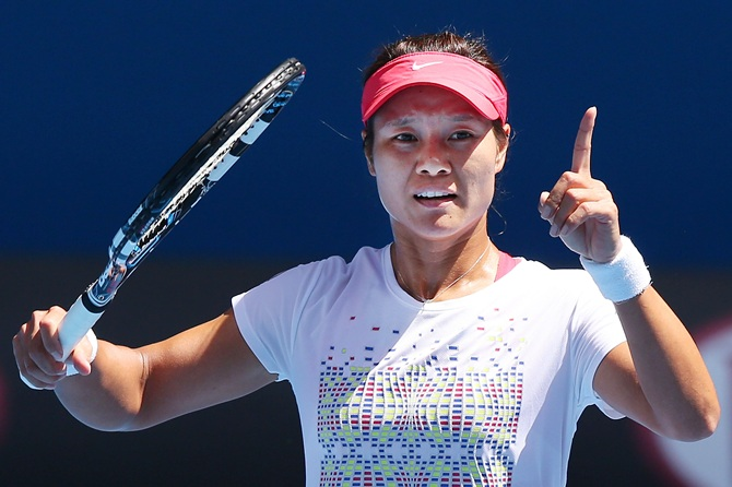 Li Na of China gestures during a training session