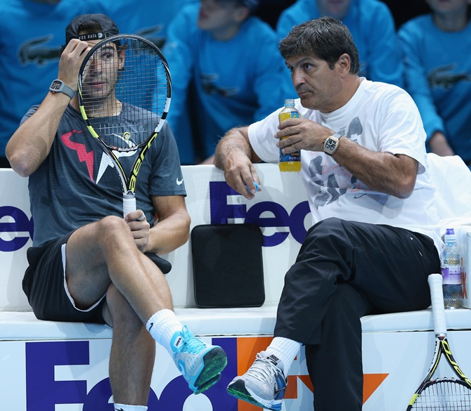 Rafael Nadal of Spain discusses tatics with his coach Toni Nadal