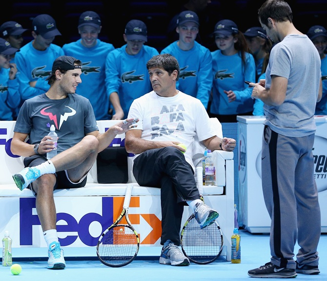 Rafael Nadal of Spain with his coach Toni Nadal