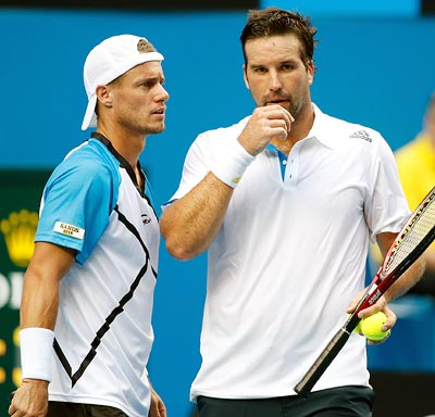 Pat Rafter (right) speaks to Lleyton Hewitt