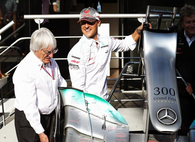 Bernie Ecclestone (left) with Michael Schumacher during qualifying for the 2012 Belgian Grand Prix
