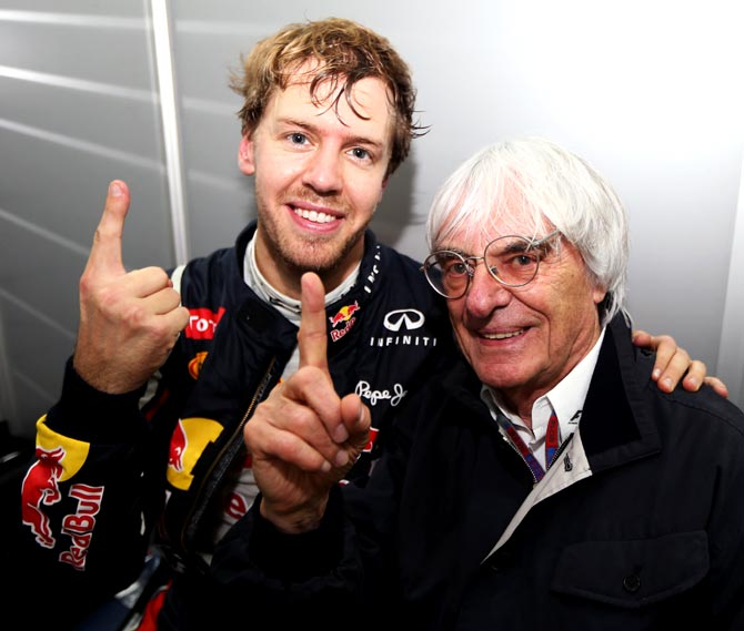 Bernie Ecclestone (right) with Sebastian Vettel