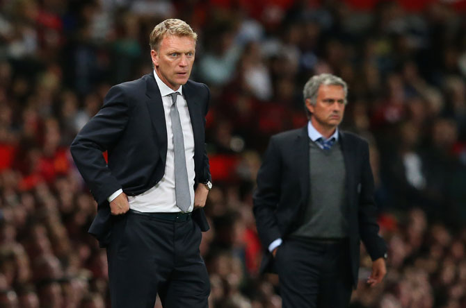 Manchester United manager David Moyes and Chelsea manager Jose Mourinho during the clash at Old Trafford in August