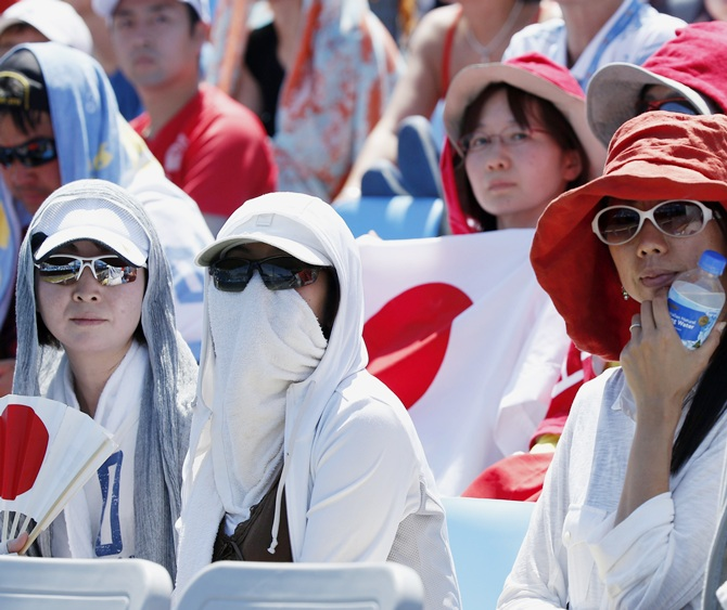 Fans watch the men's singles match between Dusan Lajovic of Serbia and Kei Nishikori of Japan at the Australian Open in Melbourne on Thursday