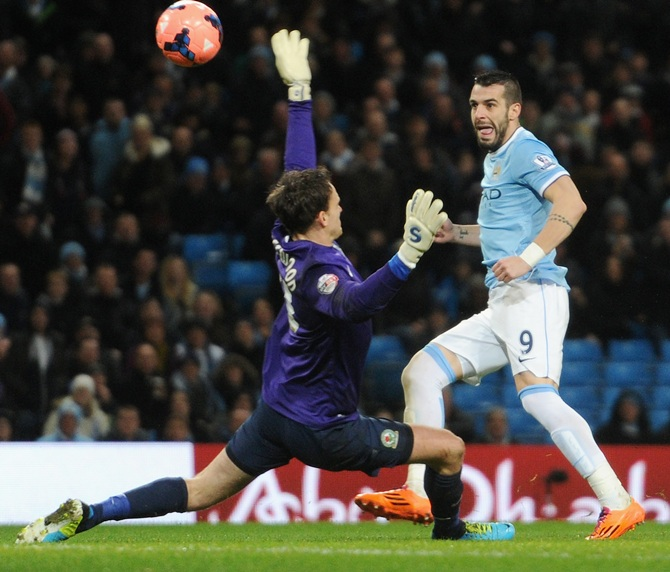 Alvaro Negredo of Manchester City scores the second goal past Simon Eastwood of Blackburn Rovers