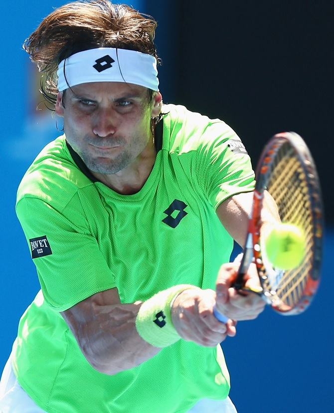 David Ferrer of Spain plays a backhand in his third round match against Jeremy Chardy