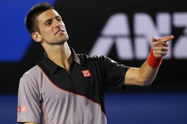 Novak Djokovic of Serbia in action against Denis Istomin of Uzbekistan