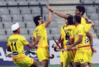 The Indian hockey team celebrates scoring a goal