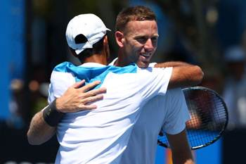 Yuki Bhambri hugs Michael Venus after victory is clinched